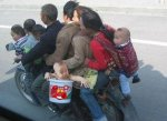 family_with_baby_on_motorcycle-300x218.jpg